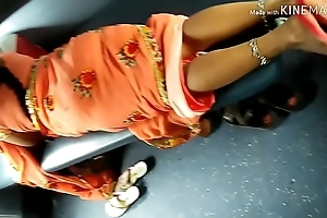 Desi beautiful Indian Aunty akin to will not hear of beautiful legs from saree in train